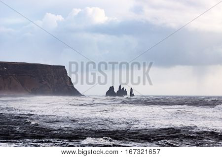 The famous Reynisdrangar stacks a stormy day in Vik in south Iceland