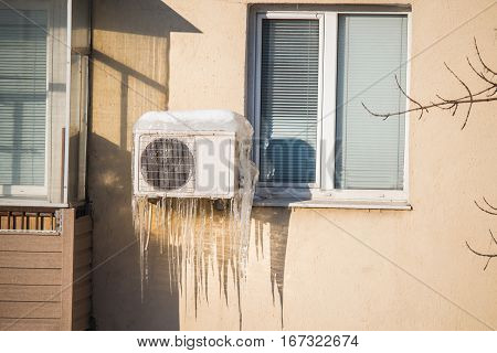 Large icicles hanging from the air conditioner