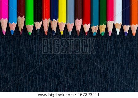 Black Background For Presentation With Colourful Upper Border Of Pencils