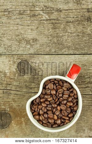 Cup Of Coffee Beans On Old Wooden Table. Sales Of Coffee. Decorations For The Menu. Coffee Shop.