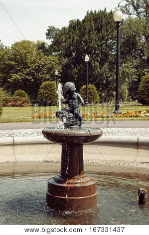 Boston, Massachusetts, US, 27 Jul. 2009: Small Child Fountain by Mary E. Moore in Boston Public Garden, near Arlington St. Erected in 1929, made of bronze and granite.