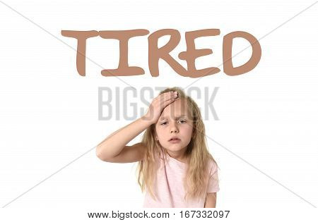 learning English language vocabulary school card with the word tired and sweet cute little female child touching her head suffering headache looking exhausted and sad isolated on white