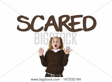 English language vocabulary learning school card with the word scared and schoolgirl in pigtails and uniform looking amazed shocked and surprised in female child face expression isolated on white