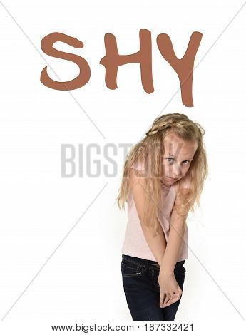 learning English language vocabulary school card with the word shy and a sweet beautiful little girl looking timid and overwhelmed isolated on white background