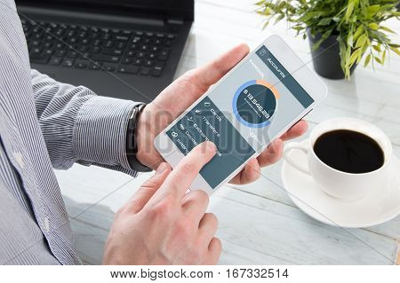 Businessman checks the account balance in mobile application