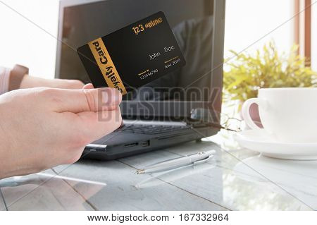 Man is holding a loyalty card while office working
