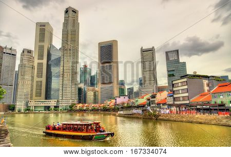 Heritage boat on the Singapore River with skyscrapers in the background