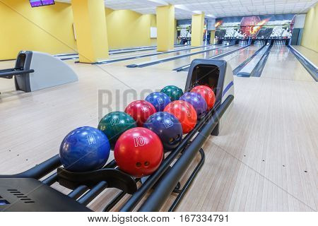 Bowling background. Interior of bowling alley lane with balls return machine closeup