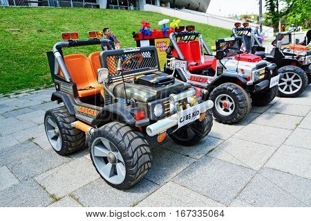 CLUJ-NAPOCA ROMANIA - JUNE 3 2016: Electric toy cars for kids to rent. Kiddie ride in the park.