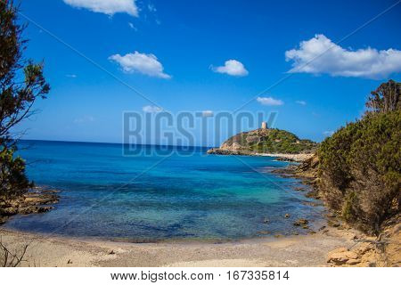 Sardinia Italy Torre di Chia bay with blue sky