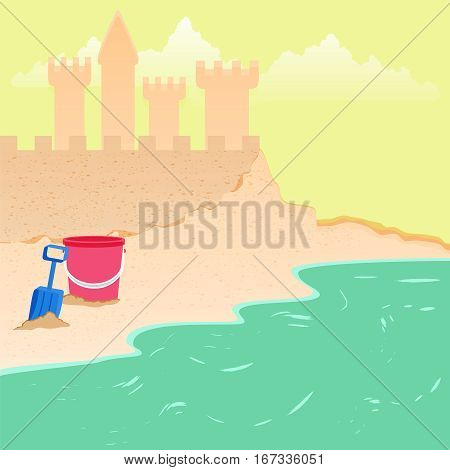 Summer fun sand castle at the beach with toy bucket shovel.