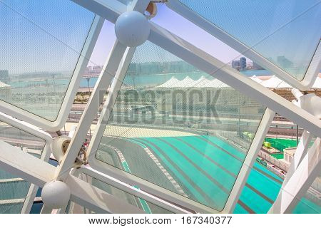 Abu Dhabi, United Arab Emirates - April 22, 2013: aerial view of Yas Marina Circuit Formula 1 from one of glass panels on iconic Yas Viceroy Abu Dhabi's Yas Island, the 5-star luxury Resort Hotel.