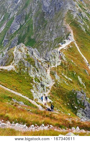 Tatra Mountains, Poland - August 22, 2015: Group Of Tourists Walk To The Top Of The Szpiglasowy Wier