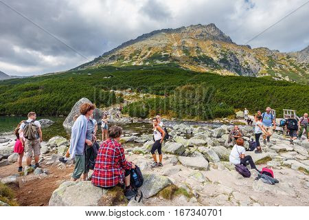 Tatra Mountains, Poland - September 10, 2017: Group Of People Resting After A Hike In Five Lakes Val