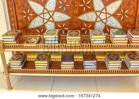 Closeup of Quran books in the Sheikh Zayed Grand Mosque located in Abu Dhabi, capital city of United Arab Emirates. Islamic culture and Muslim religious concept.