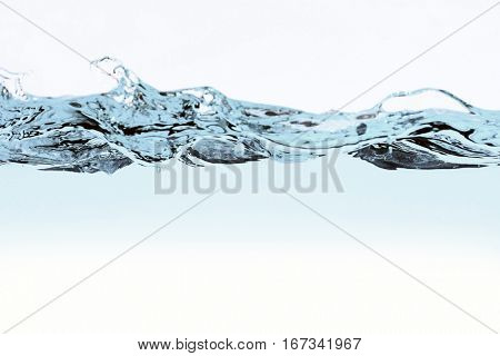 Water wave and bubbles over white background. Water splash with bubbles of air, isolated on the white background.