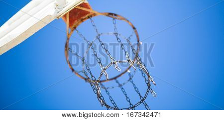 Basketball hoop and backboard--horizontal view from behind with a sky background.