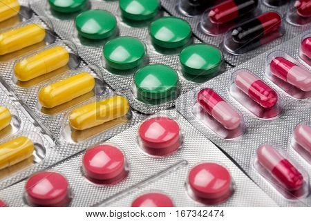 many pills yellow green black and red