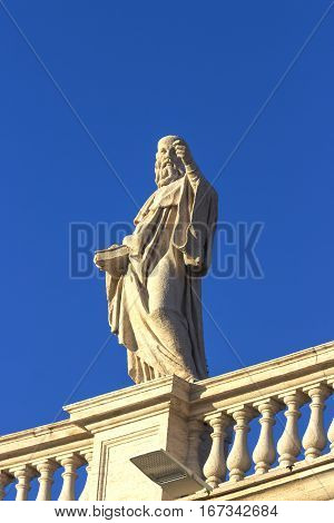 Statue of the famous Colonnade of St. Peter's Basilica in Vatican, Rome, Italy