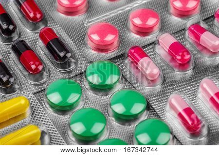 background of pills in pain green red yellow