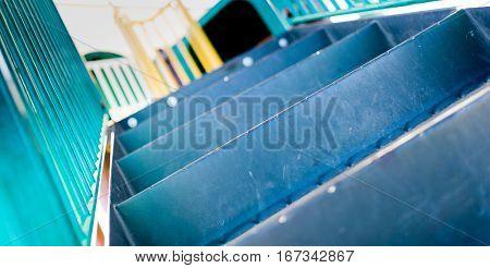 Children's play park slide steps. Close up, horizontal, depth-of-field view.