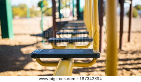 Children's play park crossing steps. Horizontal, eye-level depth-of-field view.