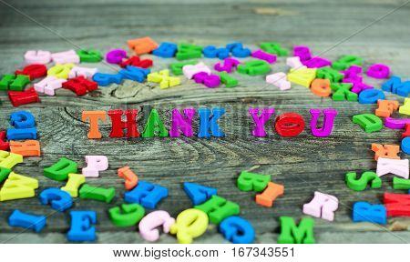 Multicolored letters of the English alphabet the words thank you