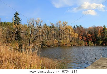 The fall landscape with lake and forest