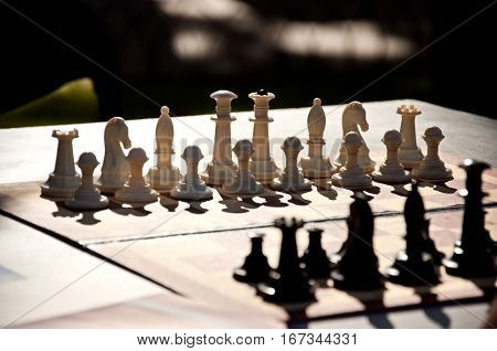 Chess Game. White And Black Chess Pieces On The Board.