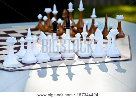 Chess Game For Three Players. Chess Pieces On The Hexagonal Board.