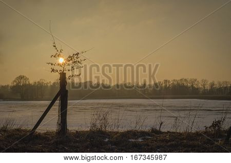 Warm sunset over dry lake in winter