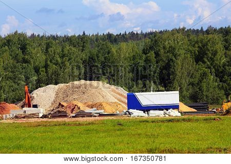 Building materials equipment and technics to start preliminary industrial construction works