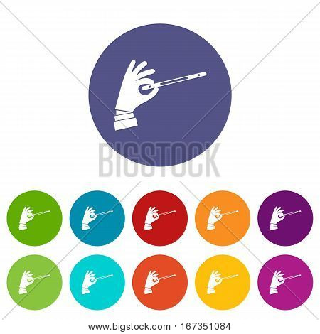 Magician hand with a magic wand set icons in different colors isolated on white background