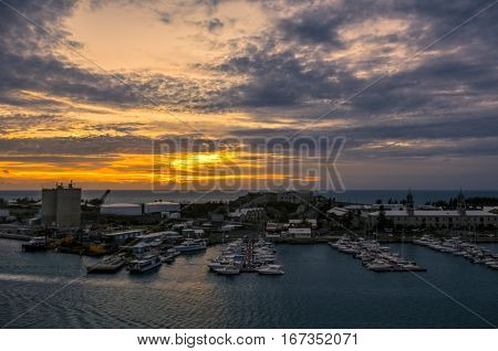 The Bermuda Royal Naval Dockyard at Kings Wharf on Ireland Island. This is located in Sandy's Parish Bermuda. The clocktower mall and National Museum of Bermuda are prominent in the photo. Photographed during the evening sunset.