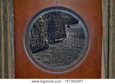 The Cliffs of Moher in Ireland Seen Through Porthole of a Ship