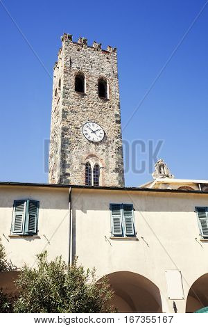 Monterosso clock tower and blue sky. Monterosso Liguria Italy.