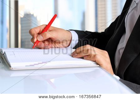 business woman working and analyzing financial figures