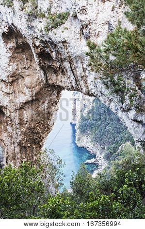 Rock arch on Capri Island. Capri Campania Italy.