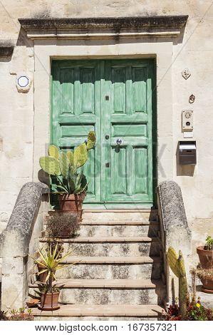 Colorful architecture of Matera - green door. Matera Basilicata Italy.