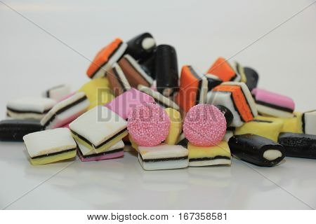 Pile of liquorice allsorts in different shapes colors and sizes