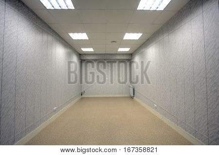 Small abandoned office space with no windows and unfurnished.