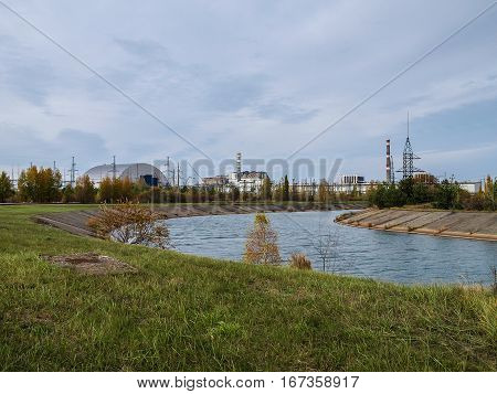 Chernobyl nuclear power station with damaged reactor block 4 and the new sarcophagus