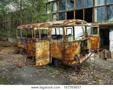 Rusty bus at the former Jupiter factory in Pripyat the ghost town in the Chernobyl Exclusion Zone which was established after the nuclear disaster