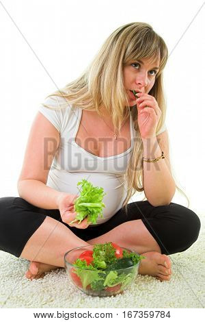 pregnant woman eating fresh vegetables