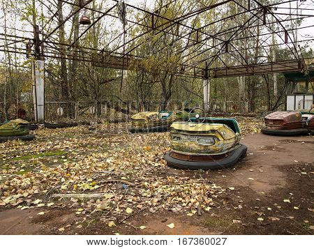 Former amusement park with bumper cars in Pripyat the ghost town in the Chernobyl Exclusion Zone which was established after the nuclear disaster