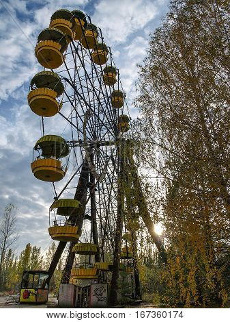 Former amusement park with a ferris wheel in Pripyat the ghost town in the Chernobyl Exclusion Zone which was established after the nuclear disaster