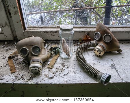Gas masks lying on a window board in the ghost town Pripyat in the Chernobyl Exclusion Zone which was established after the nuclear disaster in 1986