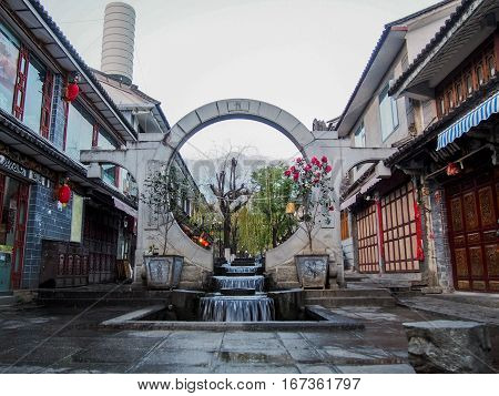 A circular fountain on the traditional streets of Dali's old city in the Yunnan province of China.