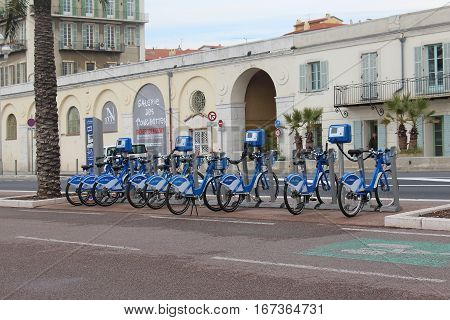 NICE FRANCE - FEBRUARY 03; Self service Veloblue rental bike station in Nice France - February 03 2016: Veloblue is an alternative way of exploring the destination by following the 125 kilometres of cycle tracks in France Cote dAzur