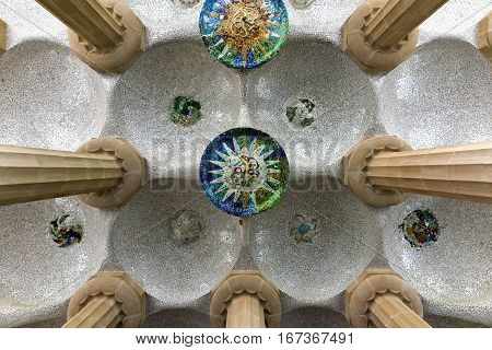 Barcelona, Spain - November 24, 2016: Hypostyle room in Park Guell in Barcelona Spain. It is a public park system composed of gardens and architectonic elements located on Carmel Hill in Barcelona Catalonia (Spain).